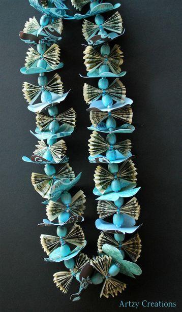 Бусы с бабочками, сделанные из старых купюр. Фото с сайта artzycreations.com