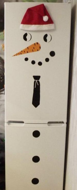 К Новому году холодильник превращается в снеговика. Фото: архив семьи АРЦИМЕНЯ