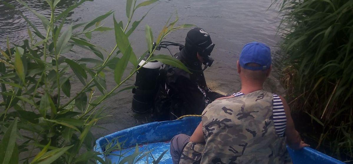 Барановичские водолазы достали тело утонувшего в Белоозерске мужчины. Фото